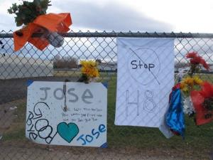 Friends have added a message to Jose Reyes and a small wooden cross at a memorial pictured Monday, Oct. 28, 2013, outside Sparks Middle School.