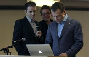 Then-president of Russia Dmitry Medvedev, right, writes a Twitter message as co-founders Evan Williams, left, and Biz Stone watch at the Twitter office in San Francisco, Wednesday, June 23, 2010.