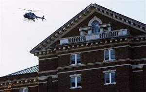 A Connecticut State Police helicopter circles James Hall on the campus of Central Connecticut State University, Monday, Nov. 4, 2013.