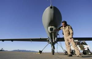 US Customs Border Patrol Air and Marine Division Deputy Director Supervisory AIA Pete McNall checks the camera on a Predator drone unmanned aerial vehicle at Fort Huachuca, Arizona.