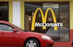 A car moves through a McDonald's drive through window line, in Springfield, Ill.