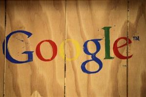 In this Oct. 17, 2012 file photo, a Google logo is painted on the side of a plywood box at Google offices in New York.