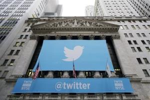 Twitter signage is draped on the facade of the New York Stock Exchange Thursday.