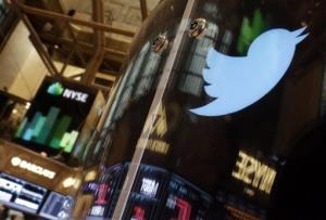 The Twitter bird logo is on an updated phone post on the floor of the New York Stock Exchange, Wednesday Nov. 6, 2013. Twitter's initial public offering was priced at $26 a share, Wednesday evening, and is expected to start trading on the New York Stock Exchange on Thursday.
