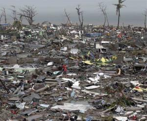 Destroyed houses lie in Tacloban city, Leyte province, central Philippines .
