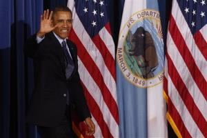 President Barack Obama waves as he arrives to speak at the 2013 Tribal Nations Conference, Wednesday, Nov. 13, 2013, at the Interior Department Washington.