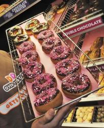 A rack of donuts is displayed at a Dunkin' Donuts franchise in Boston.