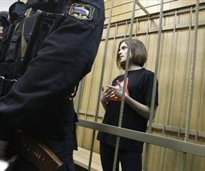 In a file photo, Nadezhda Tolokonnikova, a member of the female punk rocker band Pussy Riot, stands in a defendants' cage prior to a court hearing in Moscow, Russia.
