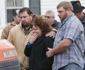 Daughter Rita Webb and sons Matthew and Nathaniel Webb watch as Patsy Davis' body is exhumed in Stevenson, Ala.