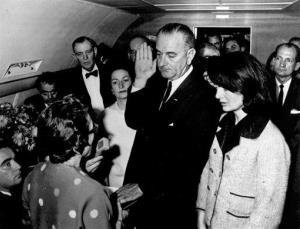 In this Nov. 22, 1963, file photo, Lyndon B. Johnson is sworn in as president Jacqueline Kennedy stands at his side in Dallas.