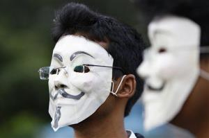 Members of a hacking group Anonymous India wear Guy Fawkes masks as they protest against Indian government enacted laws.