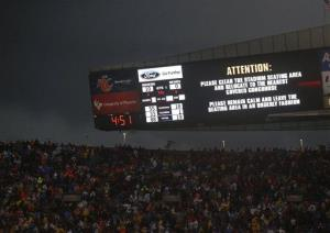 Fans are warned to take cover as a severe storm moves through Soldier Field during the game between the Chicago Bears and Baltimore Ravens, Sunday, Nov. 17, 2013.