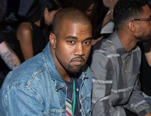 This Sept. 7, 2012 file photo shows Kanye West at the Alexander Wang collection during Mercedes-Benz Fashion Week in New York.