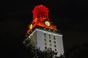 University of Texas at Austin Tower glowing in white/orange to celebrate an athletic victory that day.