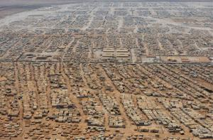 This Thursday, July 18, 2013 aerial view photo, shows the Zaatari refugee camp near the Jordanian city of Mafraq, some 5 miles from the Jordanian-Syrian border.