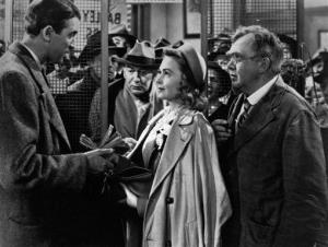 James Stewart, left, Thomas Mitchell, right, and Donna Reed appear in the 1946 movie It's A Wonderful Life, directed by Frank Capra.