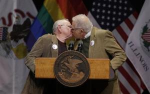 Lifelong partners Jim Darby, left, and Patrick Bova kiss before Illinois Gov. Pat Quinn signs the Religious Freedom and Marriage Fairness Act into law.