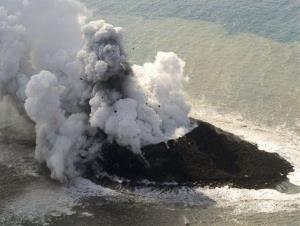 Smoke billows from a new island off the coast of Nishinoshima, a small, uninhabited island in the Ogasawara chain, far south of Tokyo.