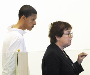 In this Oct. 23, 2013, file photo, Philip Chism, 14, stands during his arraignment for the death of Danvers High School teacher Colleen Ritzer, as his attorney Denise Regan speaks on his behalf.