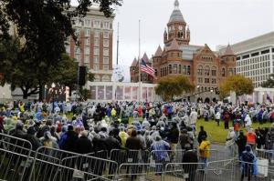 A crowd gathers before a ceremony at Dealey Plaza in Dallas.