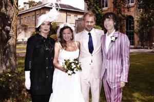 This photo dated June 30, 2012, shows Jade Jagger, 2nd left, at her wedding to Adrian Fillary, 2nd right, with her parents Bianca Jagger and Mick Jagger at Aynhoe Park, Banbury, England.