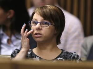 In a Thursday, Aug. 1, 2013, file photo, Michelle Knight sits in the courtroom during a break in the sentencing phase for Ariel Castro, in Cleveland.