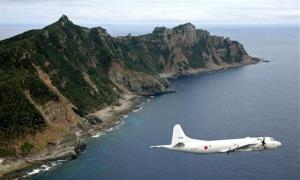 File photo of a Japanese surveillance plane flying over the disputed islands in the East China Sea.