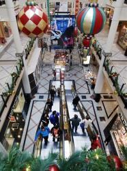 Shoppers ride escalators in a mall in Cambridge, Masachusetts.