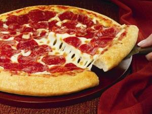 In this handout photo provided by Pizza Hut,  shows the new hand-tossed pizza. For years, Pizza Hut was a passive player in competing for fans of hand-tossed-style pizza, which represents a big slice of the market. That's about to change starting next week, when the nation's largest pizza maker will...