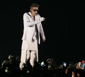 Canadian pop singer Justin Bieber performs on stage during the first Australian stop of his Believe tour at the Entertainment Centre in Brisbane, Australia, Wednesday, Nov. 27, 2013.