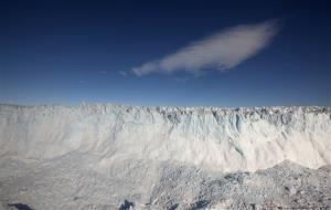 In this July 19, 2011 photo, a cloud drifts past the ever-collapsing calving 4-mile-wide front of Jakobshavn Glacier, situated at the edge of the vast Greenland ice sheet, near Ilulissat, Greenland.