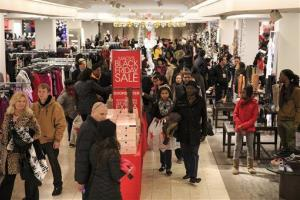 Shoppers stock up on Black Friday specials during the Macy's Lenox Black Friday store opening on Thursday, November 28, 2013 in Atlanta.