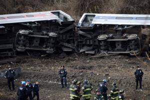 Emergency personnel respond to the scene of a Metro-North passenger train derailment in the Bronx borough of New York Sunday, Dec. 1, 2013.