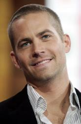 In this Feb. 14, 2006 file photo, actor Paul Walker, appears on stage during a taping for MTV's 'Total Request Live' show at the MTV Times Square Studios in New York.