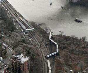 A Metro-North passenger train lays on its side after derailing in the Bronx borough of New York, Sunday, Dec. 1, 2013.