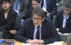 Editor of the Guardian newspaper Alan Rusbridger gives evidence to the Commons Home Affairs Committee hearing on counterterrorism at Portcullis House, central London, Tuesday, Dec. 3, 2013.