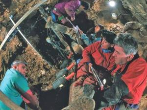 To get to the Pit of Bones, researchers had to crawl through narrow cave tunnels for hundreds of yards and rope down in the dark.