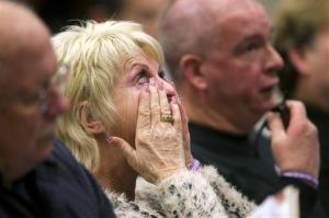 Shari Turbyfill, center, the wife of David Turbyfill, right, cries during the Industrial Commission of Arizona hearing on Wednesday, Dec. 4, 2013, in Phoenix.