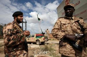 File photo. Libyan security forces stands guard in Benghazi, Libya, Saturday, Feb. 16, 2013.