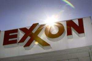 This Oct. 26, 2006, file photo shows an Exxon logo at a gas station in Dallas.