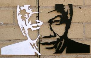 In this July 16, 2013, photo, a portrait of former South African President Nelson Mandela is seen on a wall outside his hospital in Pretoria.