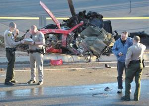 Sheriff's deputies work near the wreckage after the crash.