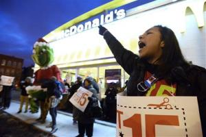 Protesters rally for better wages outside a McDonald's restaurant in Chicago, Thursday, Dec., 5, 2013.