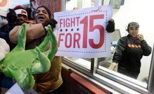 Protesters protest for higher wages outside a McDonalds restaurant in Chicago, Thursday, Dec., 5, 2013.