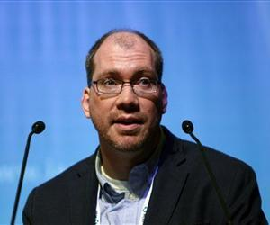 Researcher Timothy Henrich, of the Harvard-affiliated Brigham and Women's Hospital in Boston, speaks at the International AIDS Society Conference 2013 in Kuala Lumpur, Malaysia, July 3, 2013.