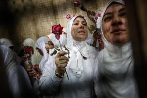 Egyptian women supporters of ousted President Mohammed Morsi stand inside the defendants' cage in a courtroom in Alexandria, Egypt, Saturday, Dec. 7, 2013.