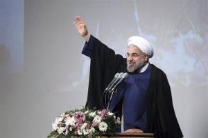 Iran's President Hassan Rouhani delivers an address to students at Shahid Beheshti University in Tehran, Iran, Saturday, Dec. 7, 2013.