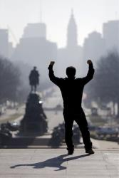 In this  Feb. 15, 2013 file photo A tourist imitates Rocky Balboa on the steps of the Philadelphia Museum of Art.
