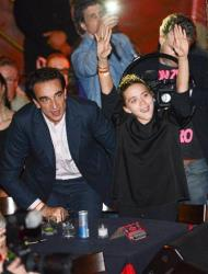 Mary-Kate Olsen and Olivier Sarkozy watch Ronnie Wood of the Rolling Stones perform with guitarist Mick Taylor, drummer Simon Kirke, and keyboardist Al Cooper on Nov. 7, 2013, in New York.