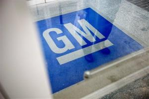 In this Thursday, Jan. 10, 2013 file photo, the logo for General Motors decorates the entrance to a former UPS facility in Roswell, Ga.